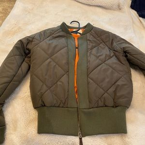 Perfect condition green puffer jacket.